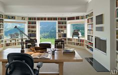 Amazing office - bookshelf lined walls, great light, even a fireplace. That's IF you can stop staring at that unbelievable view. I need this office.