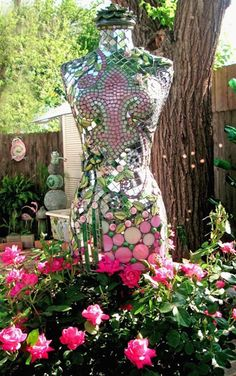 This glittering mosaic-covered mannequin is ready to party...in the garden.