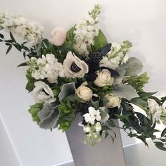 Card Table arrangement with Stock, Roses and Anemones
