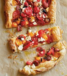 Tomato and Feta Tart | Puff pastry dough with a simple topping of tomatoes, cheese and herbs, and then baked until the dough is golden brown and flaky.