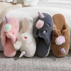 Add a touch of magic, with these adorable plush unicorn slippers. Your feet will thank you for the warm and cozy way that these slippers hug your feet. There are several color options available, and a variety of sizes. These fun slippers are just perfect for those chilly winter nights. Get a pair for you and a pair for your daughter, you're sure to both love how cuddly your feet feel. Winter Slippers, Winter Night, Hug You, Warm And Cozy, Unicorn, Baby Shoes, Plush, Daughter, Magic