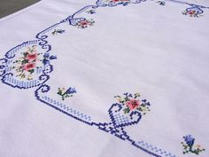 cross-woven cotton with hand embroidered cross stitch table topper