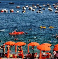A crush of orange umbrellas in Capri, captured by Tory on vacation years ago.