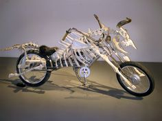 I'm loving Billie Grace Lynn's Mad Cow Motorcycle.  A combination of electric motorcycle & cow bones. Now that's a work of art!