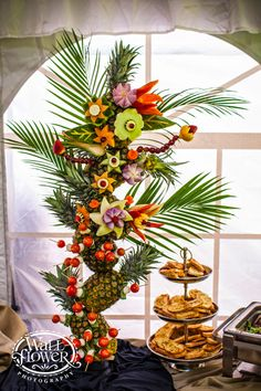Photo of a sculpture of fruits and vegetables carved into flower shapes, designed by The Ram Catering, by Wallflower Photography of Tacoma