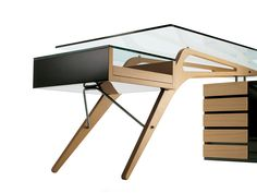 An elegant and streamlined writing desk featuring a glass top and oak frame.