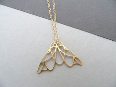 This is a small moth necklace, a smaller version of our moth necklace. This small moth necklace measures 2 cm x 3 cm The crane is made of
