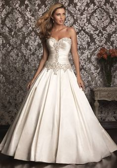 Satin ballgown with a sweetheart neckline and rhinestone appliques from The Bride's Shoppe, Great Falls, Mt