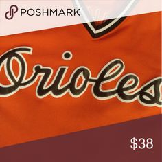 """Majestic Baltimore Orioles Cal Ripken jersey Vintage Baltimore Orioles throwback Cal Ripken jersey made by Majestic. Length 31.5"""", Width 21.5""""   This is an official MLB throwback from the Majestic Cooperstown Collection. Pullover style jersey with stitched team name, name and number. Great condition, barely worn, like new Majestic Shirts"""
