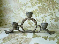 A Hobbits candle holder, oak leaves, acorn caps and wheat grain knot. $16.00, via Etsy.