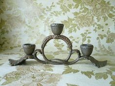 A Hobbits candle holder, oak leaves, acorn caps and wheat grain knot. $16.00, via Etsy.