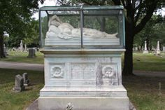 Rosehill Cemetery and Mausoleum, IL    Nineteen year old Frances M. Pearce, and her ten month old baby Frances, died in 1854, within months of each other. H.O. Stone commissioned this marble sculpture by Charles B. Ives, in his wife's and daughter's likenesses. The carving was completed in 1856, in Rome, Italy, and then shipped to Chicago, where it was placed upon the inscribed monument.   http://chicago-architecture-jyoti.blogspot.com/2011/03/rosehill-cemetery-frances-m-pearce.html