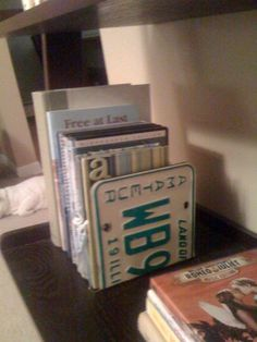 Brilliant: Repurposed old license plates into bookends; Upcycle, Recycle, Salvage, diy, thrift, flea, repurpose!  For vintage ideas and goods shop at Estate ReSale & ReDesign, Bonita Springs, FL