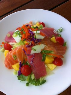 Summer Sashimi Salad served with spicy vinaigrette - part of our NEW Summer Sushi Specials at the Cornell Café!