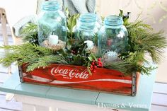 Blue Mason Jars with Holiday Greens for a casual Christmas Display. Lots of winter home decor ideas in this article! ~ Mary Walds Place - 2013 Christmas Home Tour - Hymns and Verses Coastal Christmas, Christmas Candles, Noel Christmas, Christmas Centerpieces, Country Christmas, Turquoise Christmas Decorations, Xmas, Beach Christmas Decor, Vintage Christmas Decorating