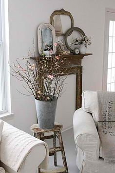 Love the framed mirror turned mantel with small frames and mirror above.