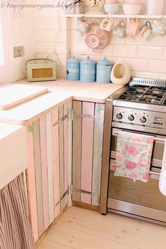 The Villa on Mount Pleasant: Kitchen Update - this is such a charming idea! I will have an empty cupboard with no door when we remove the awful garbage compactor.