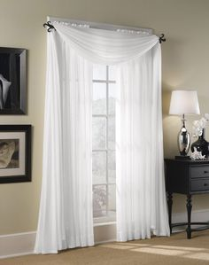"Hampton Sheer Voile Curtain Panel / Curtainworks.com Machine washable 84-inch panel: 52"" wide x 84"" long $16.99 95-inch panel: 52"" wide x 95"" long $19.99 Header: 1.5 in. Rod Pocket: 1.5 in. Hem: 4 in. Hampton Constructed of a fine, lightweight high twist voile fabric with a soft shimmer. 1.5-inch rod pocket for use with a standard drapery rod. Panel can be used as an under-treatment or as a stand-alone sheer window fashion. Pictured here with the matching Hampton Sheer Voile Scarf Valance."