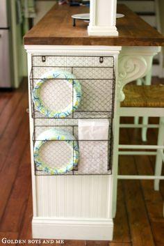 Wire basket for storage on side of kitchen island