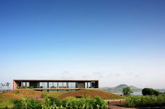 """Completed in 2014 in Nashik, India. Images by Hemant Patil, Monali Sonar. """"We should attempt to bring nature, houses and the human being to a higher unity"""" -Mies van der Rohe.  The Panorama house is set on the backwaters..."""