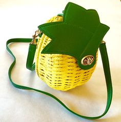 """Nothing like a pineapple purse to match your delicious tropical tiki drink! This approximately 10"""" x 6"""" x 5"""" rope-wicker purse is fully lined with an interior pocket (perfect for your phone or a compa"""