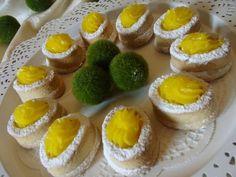 petits puits coco- citron ( petits gâteaux économiques a la noix de coco garnis de crème au citron sans oeuf