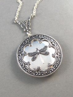 Duchess,Silver Dragonfly Locket,Wings,Antiqued,Charm,Flying,Summer,Vintage Style. Handmade jewelery by Valleygirldesigns.. $31.00, via Etsy.