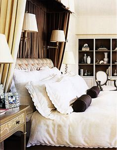Curtained bed, sconces, bolster pillows - Mary McDonald