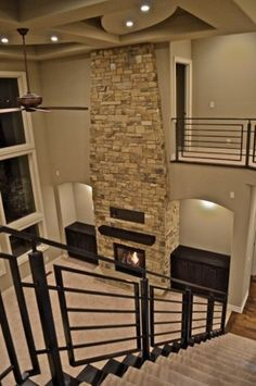 Floor to Ceiling Natural Stone Fireplace/ Open Two Story Great Room/ Custom Iron Railing/ Ceiling Detail.