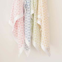 7476ed5bb2 Our triangle print Muslin Squares are hand block printed and trimmed with a  pleasing border of