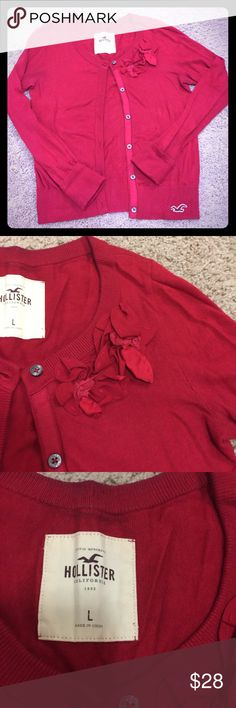 Hollister Red Cardigan Worn a few times but in good condition. Deep red color. Flower appliqué on the left side, and logo on the bottom right! Hollister Sweaters Cardigans