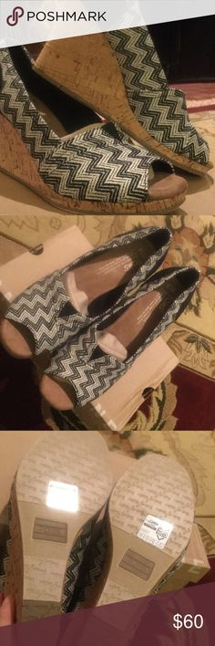 TOMS Black and White Cork Wedges NEW IN ORIGINAL BOX! TOMS Black Chevron Woven With Cork Wedge. Don't have enough room in the closet for these black and white gems! TOMS Shoes Wedges