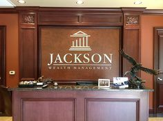 If you are an investment firm you'll want to create a sophisticated looks for your clientele buy installing brass lettering in your lobby area. www.jacksonwm.com
