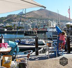 Zeker als je het hippe Kaapstad en de wijngebieden bezoekt, is het stof van Afrika ver weg. Photo: Waterfront, Cape Town, South Africa