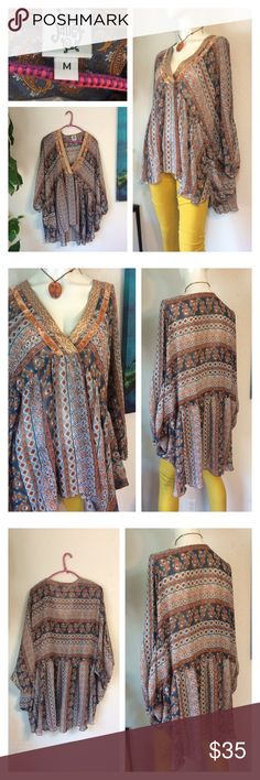 """IVY JANE PAISLEY EARTHY TUNIC PEASANT SHIRT TOP 🌻Amazing women's Ivy Jane tunic size Medium 🌻Pullover style with mixed floral and butterfly print.  🌻Chiffon style 3/4 sleeves...peasant bohemian design.  🌻Unworn - nwot! 🌻Comfortable and looks great on! Awesome addition to your wardrobe. Made of 100% polyester... 🌻Approx measurements laid flat- (double where necessary) Underarm to underarm: 35"""" Waist: free Hips: free Shoulder to hem: 29"""" front 35"""" back ivy jane Tops Tunics"""