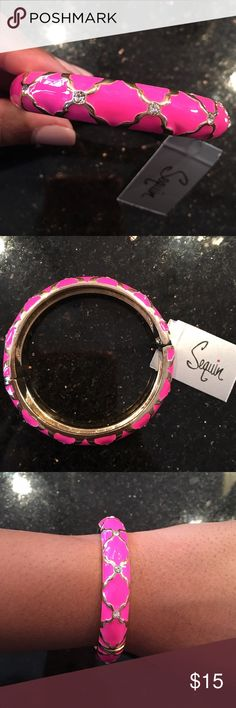 Hot Pink Enamel Bangle Hot Pink Bangle with gold and rhinestone detailing. Perfect for stacking with other bracelets or to wear on its own! Brand new, with tags! Clasp closing/opening - very easy and stylish piece! Nordstrom Jewelry Bracelets