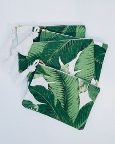 Jumping on that Greenery trend! A modern zipper pouch thats great for holding all the accessories you dont want to loose track of in a larger bag. Its also cute on its own as a little clutch or makeup bag.  Its made from the super popular beverly hills style palm / banana leaf print and covered in vibrant green leaves. I use this pouch for all the extras - lipgloss, phone, etc. It keeps things secure and makes it easy to find them all in one place. If youre like me you know lip glosses a...