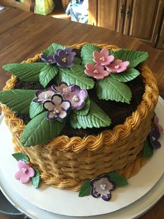 Lemon cake/frosting, buttercream basketweave and rope border.  Gum paste/fondant African violets and leaves made my my dad and I for my mother's birthday.