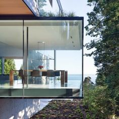 Protruding glass boxes offer ocean views from Russet Residence by Splyce Design