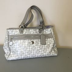authentic Coach bag!!! Stunning multi gray. This coach purse is a good size purse. It's about 15 inches wide and 9 high. Width is about 5 inches. Great bag!! Lots of pockets and places to organize. This bag is vynil! Not a cloth so easy to keep looking like new!!! Trade value 250 Coach Bags