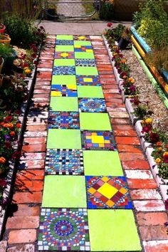 Mosaic and brick paver path I did for my front yard garden. Some variation of this my be fun for the back yard paths. Mosaic Walkway, Mosaic Stepping Stones, Pebble Mosaic, Mosaic Art, Stone Mosaic, Mosaic Projects, Garden Projects, Brick Projects, Mosaic Ideas