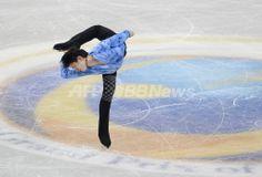 羽生が男子SP歴代最高で首位、GPファイナル 国際ニュース:AFPBB News