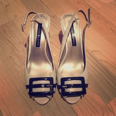 Bandolier heels Cute beige color heels with belt detail in front. Size 6 Bandolino Shoes Heels