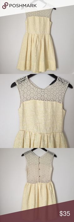 """Zara Woman Eyelet Crochet Back Yellow Marled Dress Zara Woman brand dress in size Extra small. Yellow and White Marled textured pattern. Eyelet Crochet Knit (in off-white/cream) on front top and back. Back is open and will show your back. Sleeveless. Comes with an extra button for the back (just in case!). Gathered waist flatters your shape! 32 1/2"""" long, bottom hem 28 1/2"""" across, waist 12 3/4"""" laying flat, pit to pit 15 3/4"""". Good condition- minor wear/snagging/pilling. NO TRADES. Zara…"""