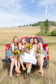 Rustic Country Wedding - Bride and Bridesmaids in truck bed - Jamie V Photography