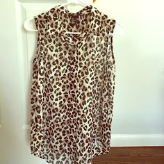 Sleeveless chiffon leopard print blouse Sleeveless leopard print button down blouse. H&M Tops Blouses