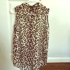 Sleeveless chiffon leopard print blouse Sleeveless leopard print button down blouse. H&M Tops Blouses
