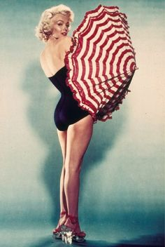 Posing with a parasol in Fifties pin-up, 1954