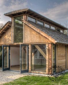 Douglas Fir Timber Framed Music Room and Outbuilding by Carpenter Oak Ltd Devon