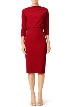 With a chic silhouette, this deep red Badgley Mischka sheath dress is sophisticated.